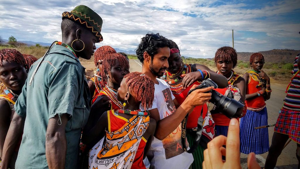 Aaron and East Pokot residents checking photos Kenya